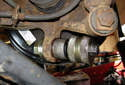 Assemble press tool and new ball joint or bushing to install into wheel bearing carrier.