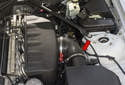 This photo shows the location of the auxiliary coolant pump (red arrow).