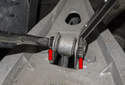Then remove the 13mm mounting fasteners (red arrows) for the sway bar end link.