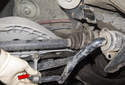Lower the sway bar with the end link attached (red arrow) down enough for drive axle to clear.
