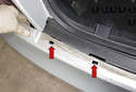 When installing bumper, slide bumper onto center mount and snap tab holes (red arrows) into place.