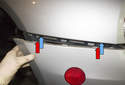 Then align bumper cover holes (red arrows) with the corner mounts (blue arrows).