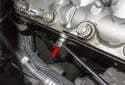 Next, remove the 17mm oil line banjo bolt (red arrow).