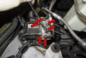 To replace the hydraulic unit and electrical unit as a unit, begin by removing the six 11mm hydraulic lines (red arrows).