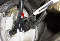 Slide the electrical connector lock away from the connector (red arrow) and disconnect the connector.