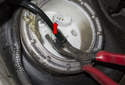 It is a tight fit, I used a pair of trim panel pliers to lever down as I released the fuel line (red arrow).