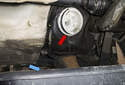 Slowly pull the fuel filter out of the tank enough to allow any remaining fuel to drain into a pan (blue arrow).