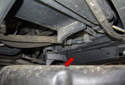Allow the coolant to drain into the bucket (red arrow).