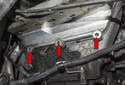 This photo shows the lower fastener holes for the VANOS actuator, with the solenoid removed (red arrows).