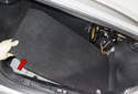 Lift floor carpet trim and remove from the trunk (red arrow).