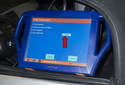 Once the module has been replaced, clear fault codes and code and program (red arrow) the new module using an advanced BMW scan tool.