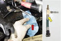 Working at the fuel delivery line on the left side of the engine (red arrow), press the plastic collar toward the line and hold while you slide line off the engine.