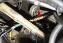 Follow the instruction for your test kit and install the T-adapter (yellow arrow).