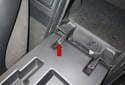 Open the rear storage compartment door.