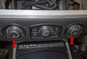 Press the panel into the instrument panel about 1/2 inch on each side (red arrows) before trying to remove it.
