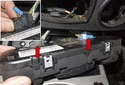 Pull the panel out of the opening at the bottom of the instrument panel.