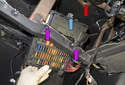 Push the fuse panel toward the firewall as you pull it down, detach the top grommet (blue arrow) from the bore (red arrow) at the instrument panel.