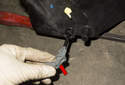 To remove the coolant level sensor, rotate the sensor 90° counterclockwise and pull it straight out (red arrow).
