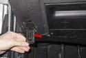 Fold open the OBD II connector access door (red arrow).