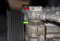 Working under your vehicle at the front corner, use a 22mm wrench to remove the PS pump high-pressure line (red arrow).