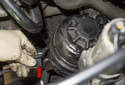Rotate the mounting bracket 180° (red arrow) toward the radiator.