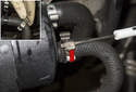 Use a small flathead screwdriver and lever open the hose clamp (red arrow).