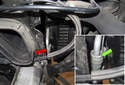 If you need to replace the hose that runs to the power steering cooler (red arrow), press the gray collar toward the hose (green arrow) and hold it while pulling the hose straight off the cooler line.