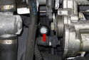 Bank 1: Working at the knock sensor, remove the 13mm knock sensor fastener (red arrow).