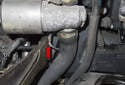 Repeat the previous step for the lower hose clamp (red arrow).