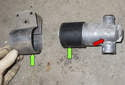 Depending on how you purchase a new valve, you may have to swap the mount and the rubber insulator over (green arrows).