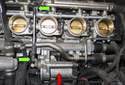 With the manifold removed, you have clear view of the EDR (red arrow) and the connecting rod (green arrows) to the throttle bodies.