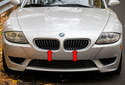 The radiator grilles consist of two grilles (red arrows) mounted in the radiator support above the front bumper cover.