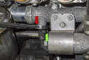 Coolant sensor: On my subject vehicle the coolant temp sensor electrical connector was positioned in a way that I could not access the wire retainer (green arrow).