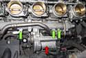 Remove the three 10mm fasteners (green arrows).
