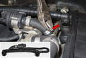 To remove the crankcase breather hose assembly (inset), cut the rubber hose clamp (red arrow) using diagonal pliers.