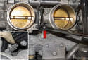 Remove the lower throttle body fasteners (red arrow).