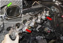 Remove the throttle bodies as an assembly from the cylinder head (red arrows).