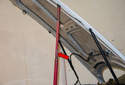 Hood Support Struts: Use a rod or hood support (red arrow) to hold the hood open while you remove the struts.