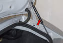 Trunk Support Struts: The trunk support struts hold the weight of the hood or trunk lid when opened (red arrow).