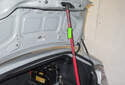 Trunk Support Struts: Use a rod or hood support (green arrow) to hold the hood open while you remove the struts.