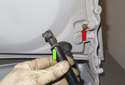 Trunk Support Struts: Clean the support strut mounting points and apply a small amount of grease (green arrow).