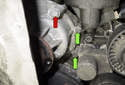 Next, remove the two-left side 10mm water pump-mounting fastener (green arrows).