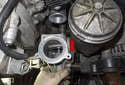 With all the fasteners removed, pull the water pump away from the engine to detach it (red arrow).