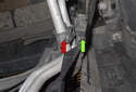 This photo shows the lines (red arrow) being pulled out of the plastic bracket (green arrow).