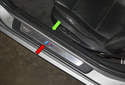 The doorsill is trimmed by two separate pieces -- one covering the inner doorsill (green arrow) and one covering the outer doorsill (red arrow).