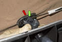 To replace or swap the headlight washers to a new bumper, start by levering (green arrow) the trim cap off (red arrow).