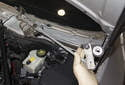 Once the fasteners are removed, slide the wiper assembly toward the left side of the vehicle.