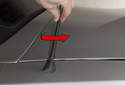 Remove the antenna rod by unscrewing in a counterclockwise direction (red arrow).