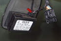 To repair or replace the rain sensor, start by unplugging the electrical connector (red arrow), pull it straight out.