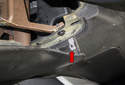 Then, lever out the right side, there is one clip there (red arrow).